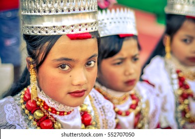 Shillong, Meghalaya - circa April 2012: Young girls wear traditional white costume with white crown-like hat at Shad Suk Mynsiem Festival in Shillong, Meghalaya. Documentary editorial.