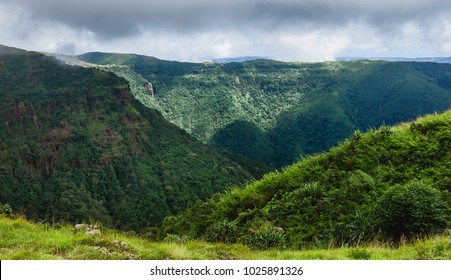 Shillong, Meghalaya, India. Khasi hills covered in forests over steep slopes and oncoming monsoon storm near Shillong, Meghalaya, India.