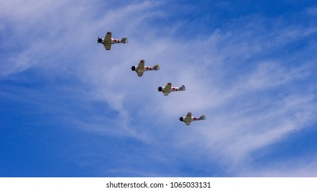 Shiloh, IL—June 10, 2017 flight of four antique Japanese navy fighter planes fly in echelon formation at airshow
