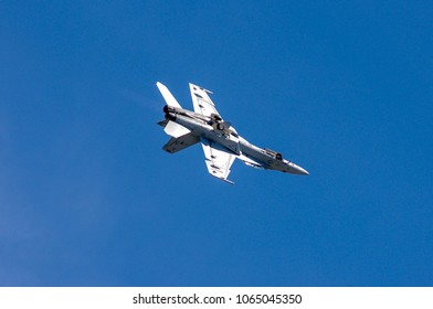Shiloh, IL—June 10, 2017 navy fighter plane rolls upside down with landing gear extended during airshow demonstration