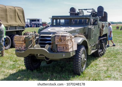Shiloh, IL—June 10, 2017; people walk around vintage army half-track on display at airshow.