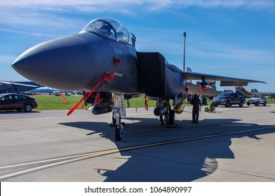 Shiloh, IL—June 10, 2017 pilot walks around military combat aircraft on static display at airshow