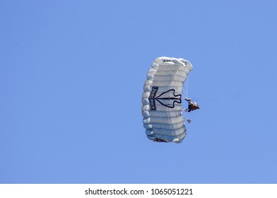 Shiloh, IL—June 10, 2017 Special operations soldier flies parasail during combat demonstration at airshow