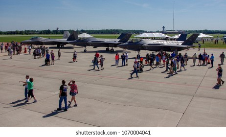 Shiloh, IL—June 10, 2018 crowds walk past stealth fighters on tarmac at airshow