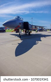 Shiloh, IL—June 10, 2018; jet fighter plan static display casts shadow silhouette on tarmac at airshow