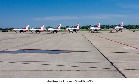 Shiloh, IL—June 10, 2018 six red white and blue aerial demonstration aircraft parked on tarmac prior to airshow
