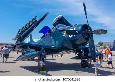 Shiloh, IL—June 10, 2018 visitors walk around antique fighter plane during airshow