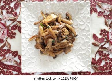 Shimeji and Maitake mushroom stir fried with pork for asian food image