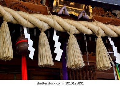 Shimenawa at Japanese shrine consists of a rice-straw rope and white paper cut in strips