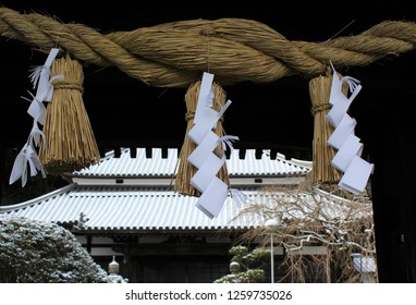 Shimenawa rope and Shide papers decorate a gate for New Year's  at Soukakuji Temple in Yatushiro City, Kumanoto Pref, Japan - Jan 12, 2018