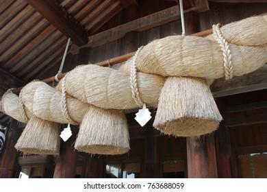 Shimenawa (sacred straw rope) at grand shinto shrine Izumo-taisha, Izumo, Japan