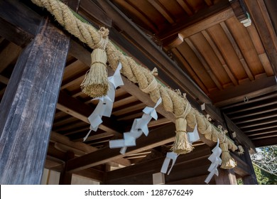 Shimenawa and Shide on the entrance to the temple in Japan