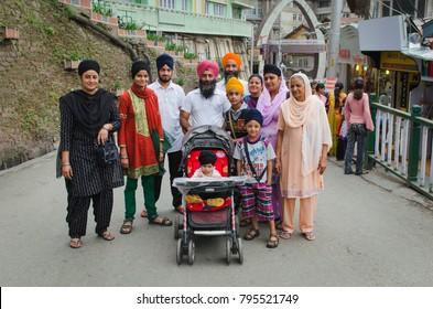 Shimla, Himachal Pradesh/ India – June 25, 2012: Big beautiful family went for a walk along the streets of the cozy town of Shimla