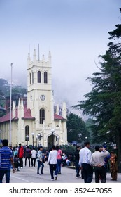 Shimla, India; 10th Aug 2013: Crowds roaming in front of the famous landmark church on mall road in shimla. Taken on a foggy day