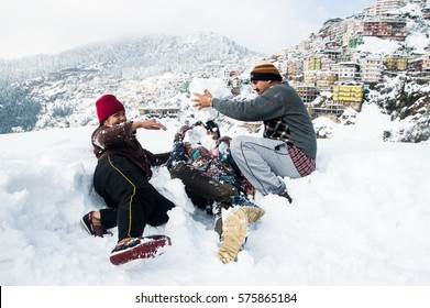 SHIMLA, INDIA - JANUARY 08, 2017: people are playing with the snow during the winter in Shimla
