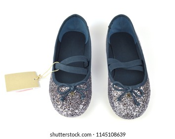 Shimmer silver blue ballerina flat shoes with crossed elastic drawstrings and a price tag on white