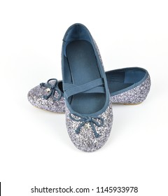 Shimmer silver blue ballerina flat shoes a small bow and with crossed elastic drawstrings on white background