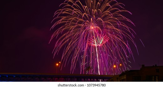 Shimmering fireworks above a highway bridge in Cleveland, Ohio