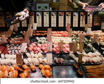 Shimonoseki JAPAN - November 27, 2016 Merchants sale seafood and sushi in Karato fish market. Karate market is one of famous fish market in Japan