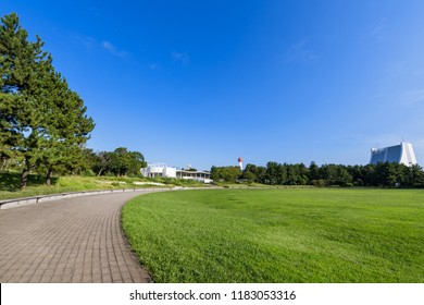 """SHINAGAWA, TOKYO / JAPAN - SEPTEMBER 5 2018 : Scenery of """"Shiokaze Park"""". It is a vast park with grass plaza and others."""
