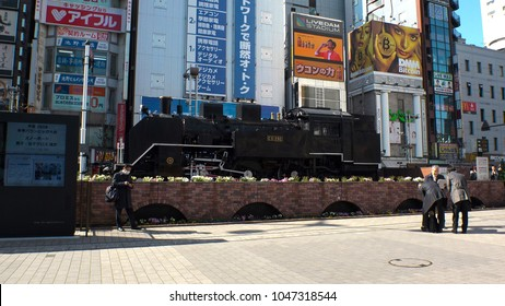 SHINBASHI,  TOKYO,  JAPAN - CIRCA MARCH 2018 : STEAM LOCOMOTIVE TRAIN at SL HIROBA (name of the place in Japanese) in front of SHINBASHI TRAIN STATION.