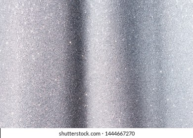 shine and sparkle of silver glitter abstract background