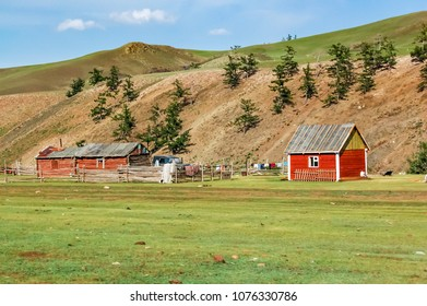 Shine-Ider District, Mongolia -  July 22, 2010: Timber houses on steppe in Khovsgol Province, northern Mongolia
