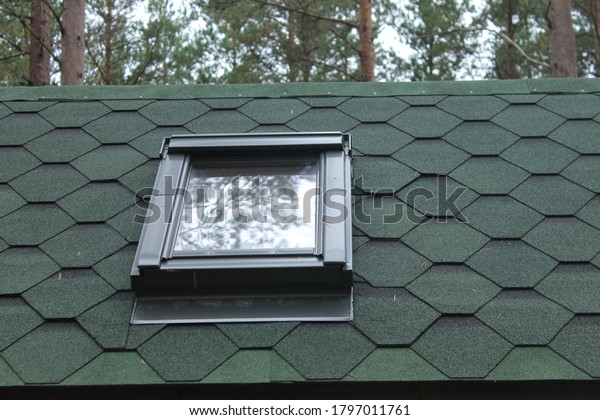 shingles-roof-top-sky-light-600w-1797011