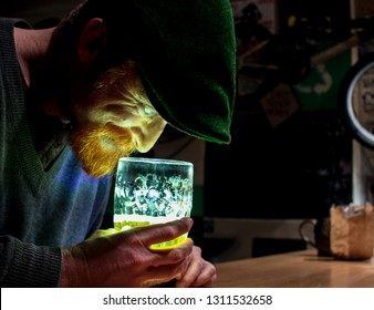 Shining beer and crazy Irish guy on St Patrick day. He is very happy about his beer and have some copy-space