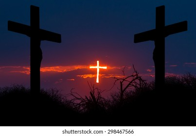 Shining cross of Christ saving sinners from the darkness. Concept of salvation, resurrection and forgiveness. The two sinners are leaning forward to the saving light, aspiring for salvation.