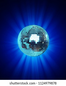 Shining Disco Ball on blue background light rey