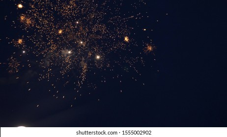 shining fireworks with bokeh lights in night sky. glowing fireworks show. New year's eve fireworks celebration. multico lored fireworks in night sky. beautiful colored night explosions in black sky