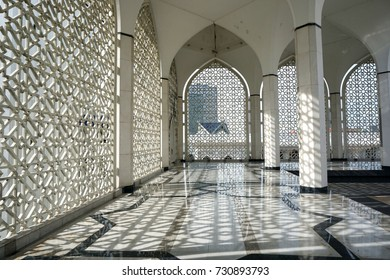 Shining floor marble reflection at mosque corridor. Islamic architecture.
