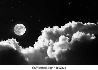 shining full moon on cloudy sky
