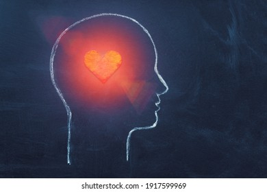 Shining Heart in human head. Love, instinct and romance concept. Chalk drawing. Copy space. Psychology, Valentine day, volunteer symbol.