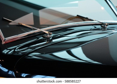 Shining hood of black elegant car and windshield