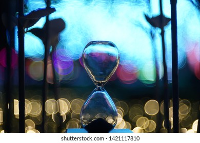A shining hourglass with colorful bubble blur background