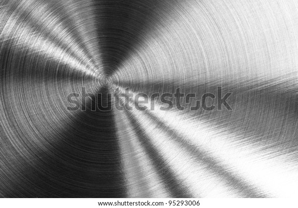 Shining Metallic Texture with circular reflections and surface patterns.