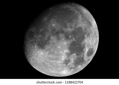 Shining Moon, in waxing gibbous phase, taken with telescope, isolated in dark background.