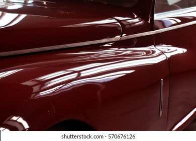 Shining red hood of classic car