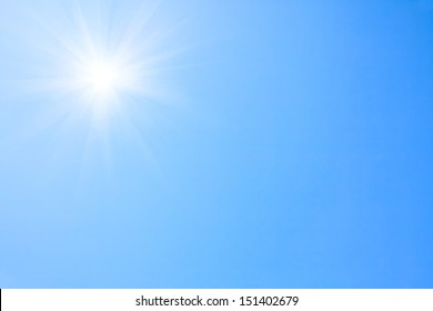 Shining sun at clear blue sky.