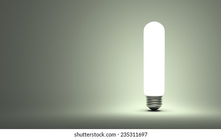 Shining tubular light bulb on gray background
