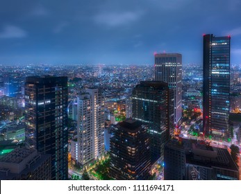 Shinjuku in Tokyo by night, skyscrapers in the colorful japanese megalopolis.