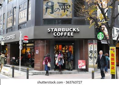 SHINJUKU, TOKYO - DECEMBER 6, 2014: Starbucks Coffee shop in the western part of Shinjuku commercial district. Around 1,000 branches in Japan.