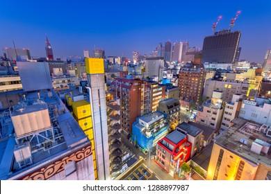 Shinjuku, Tokyo, Japan cityscape over Kabukicho at dusk.