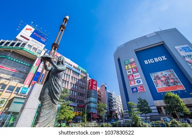"SHINJUKU, TOKYO / JAPAN - JULY 30 2016 : Scenery in front of ""Takadanobaba"" station in Shinjuku-ku, Tokyo. In the square in front of the station there is ""statue of the goddess of peace""."
