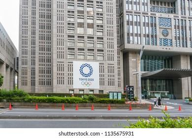 SHINJUKU TOKYO, JAPAN - June 8, 2018 : 2020 Tokyo Olympics logo symbol on Metropolitan Government Building In the middle city is Landmarks in Tokyo Japan on June 8, 2018.