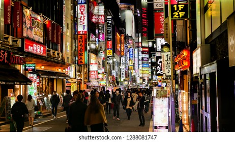 Shinjuku, Tokyo / Japan - November 14 2018: Street and illuminated billboards at night in the Kabukicho Red Light District.