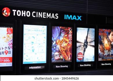 Shinjuku, Tokyo, Japan - November 2 2020:  The Kimetsu No Yaiba movie, Demon Slayer The Movie: Mugen Train is a huge box office hit in Japan. Next to Tenet poster at Toho Shinjuku.