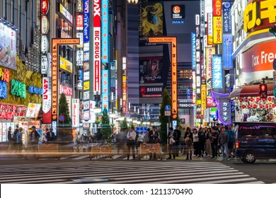 "SHINJUKU, TOKYO / JAPAN - OCTOBER 10 2018 : Night view of ""Shinjuku Kabukicho"" where flashy neon shines. It is a busy area where bars, restaurants, theaters, hotels, etc. gather. Many tourists visit."